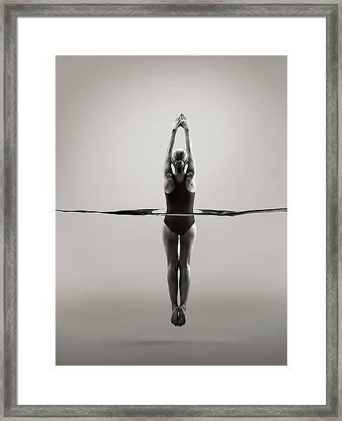 Rear View Of Female Swimmer Framed Print