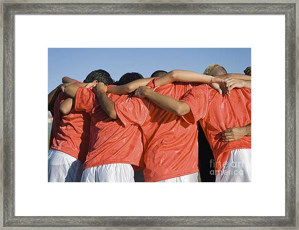 Rear View Of Young Soccer Players Framed Print
