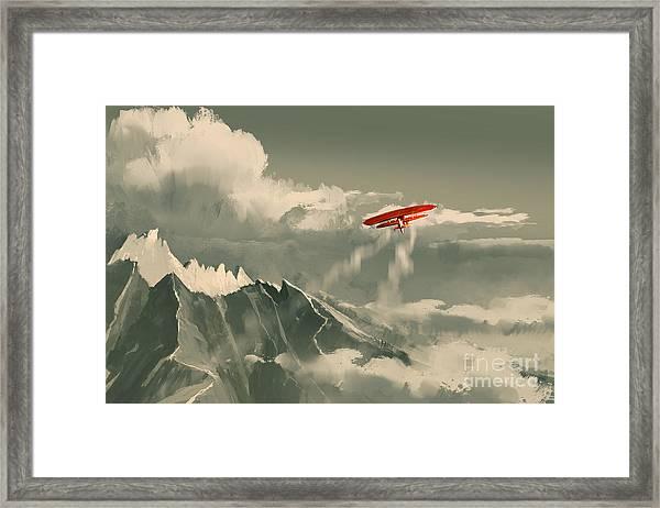 Red Biplane Flying Over Framed Print