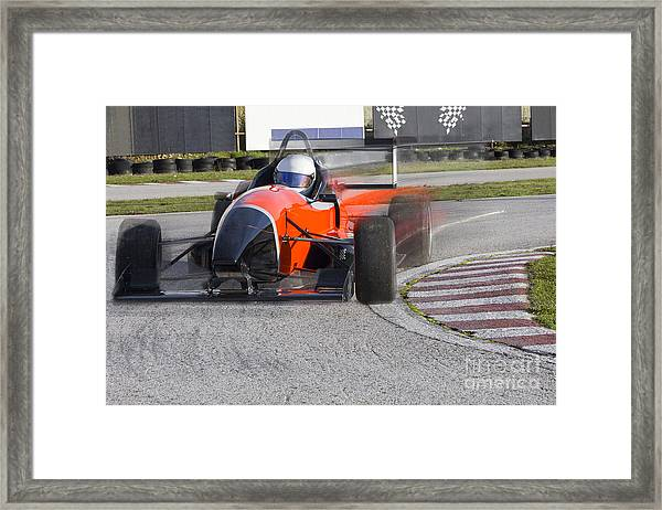 Red Bolide Driving At High Speed In Framed Print