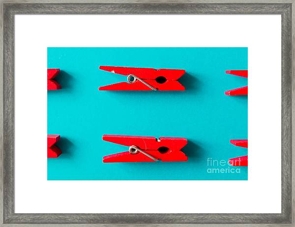 Red Clothespins On Cyan Background Framed Print by Zamurovic Photography