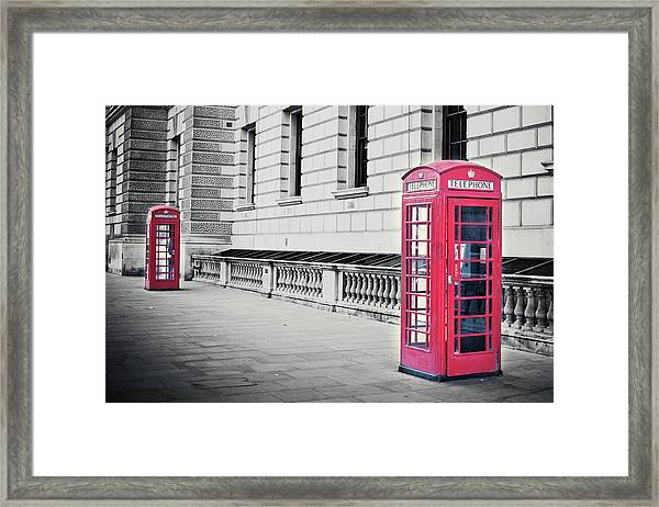 Red English Phone Booths In Black And Framed Print