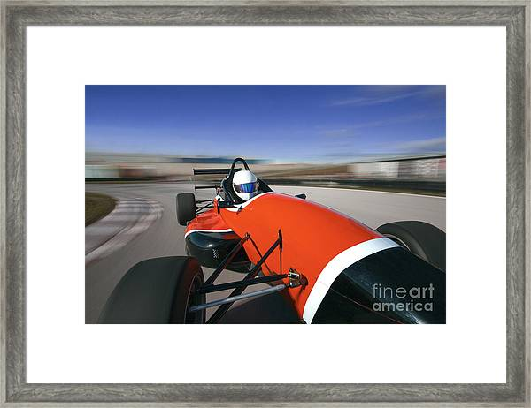 Red Racing Car Driving At High Speed In Framed Print
