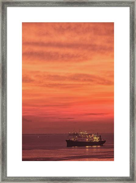 Red Sky And Red Sea Framed Print