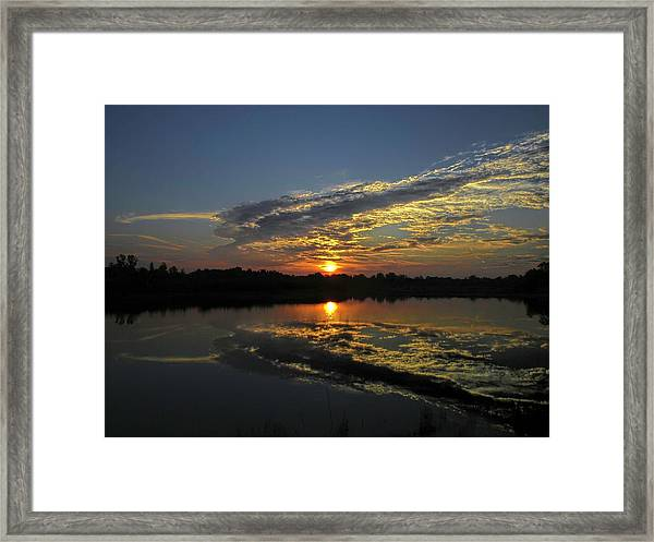 Reflections Of The Passing Day Framed Print