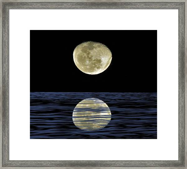 Reflective Moon Framed Print