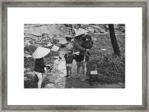 Returning Refugees Framed Print