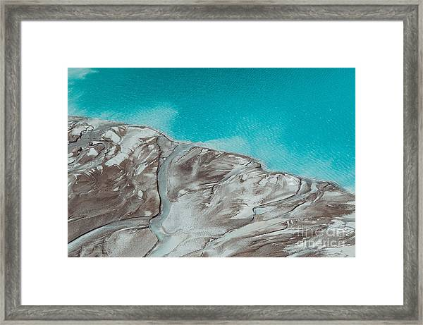 River Delta Flowing Into The Blue Pond Framed Print