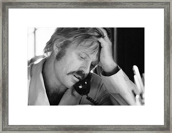 Robert Redford On The Phone Framed Print by John Dominis