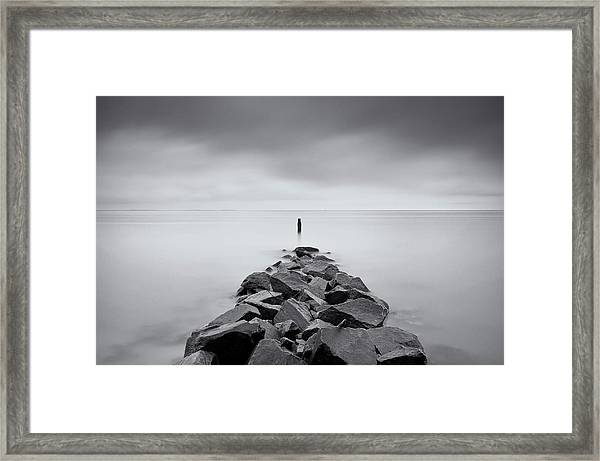 Rock Jetty At The Chesapeake Bay Framed Print