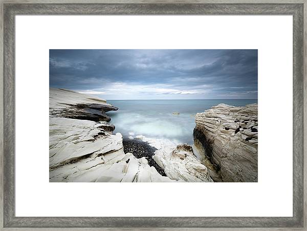 Rocky Coast With White Limestones And Cloudy Sky Framed Print