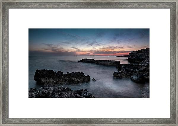 Rocky Seascape With Dramatic Beautiful Sunset Framed Print