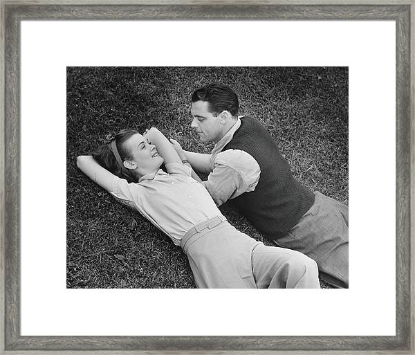 Romantic Couple Lying On Grass, B&w Framed Print by George Marks