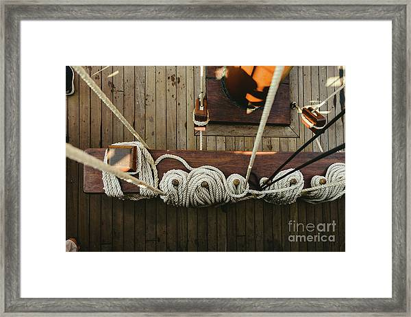 Ropes To Hold The Sails Of An Old Sailboat Rolled. Framed Print