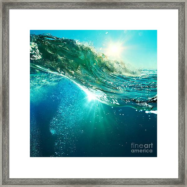 Rough Colored Ocean Wave Breaking Down Framed Print by Willyam Bradberry