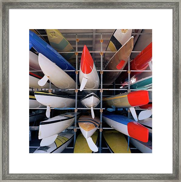 Rows Of Canoes In Boat House, Close-up Framed Print