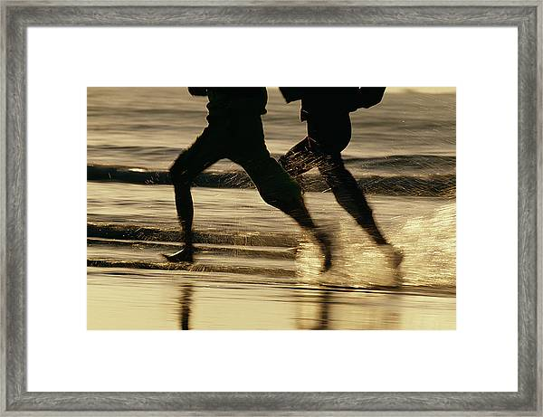 Running Couple At The Beach Framed Print