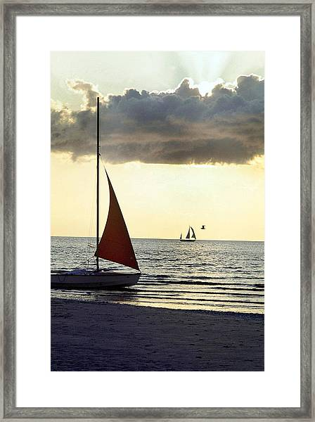 Sailboat At The Edge Of Deauvilles Framed Print