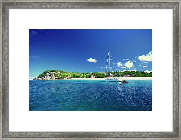 Sailboat Offshore Of Island Framed Print