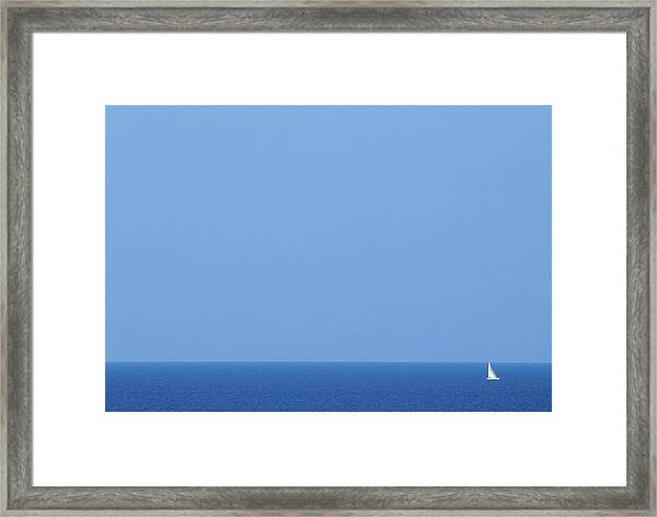 Sailboat On Calm Ocean Framed Print