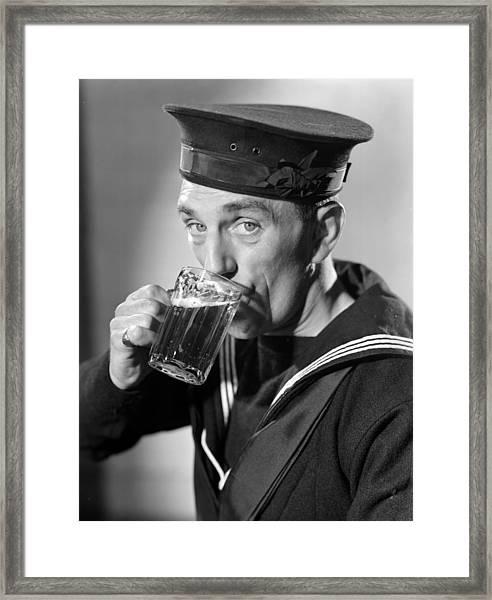Sailor Drinking Beer Framed Print by Fox Photos