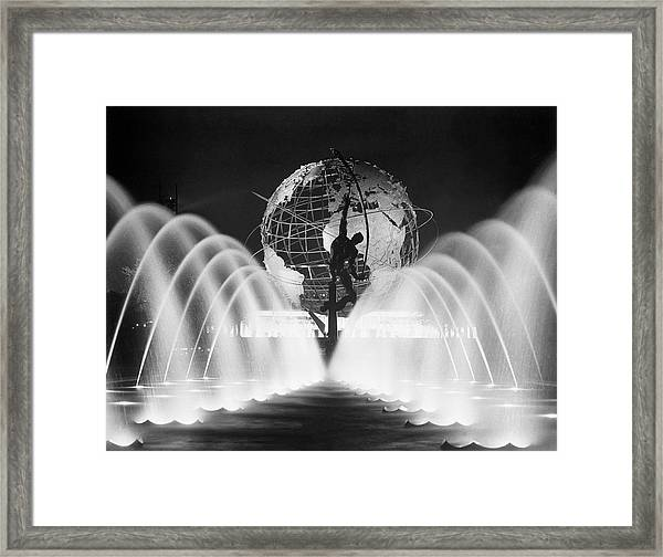 Sculpture, Fountains, And Unisphere At Framed Print by Bettmann