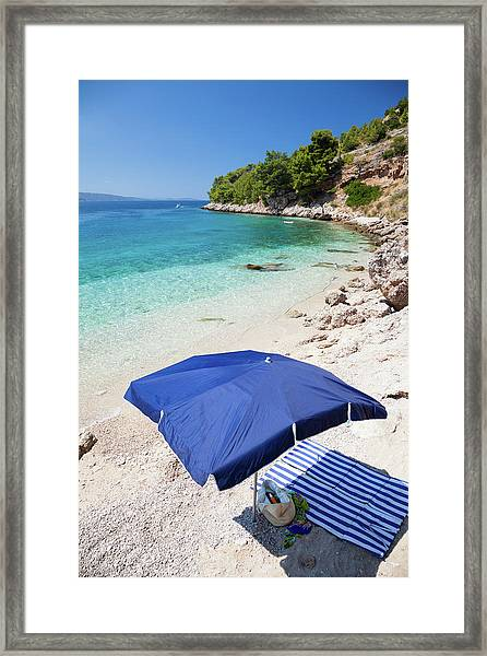 Seascape And Sun Umbrella Framed Print