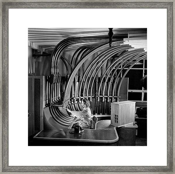 Secretary With Pneumatic Tube Framed Print by Walter Nurnberg
