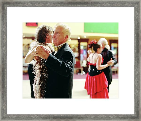 Senior And Mature Couples Dancing Framed Print