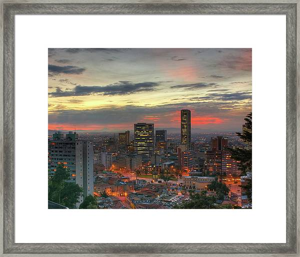 Setting Sun Over Bogotá Framed Print by Tobntno