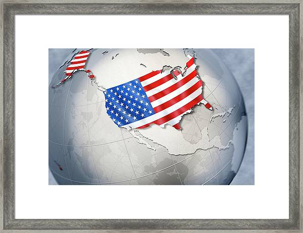 Shape And Ensign Of The Usa On A Globe Framed Print by Dieter Spannknebel