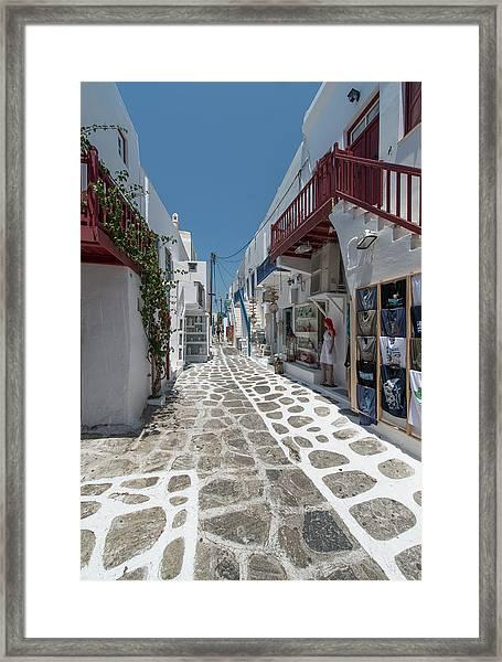 Shopping Street In Mykonos Framed Print by Ed Freeman