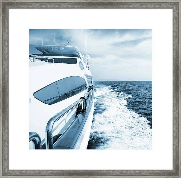 Side View Of Luxury Yacht Sailing The Framed Print