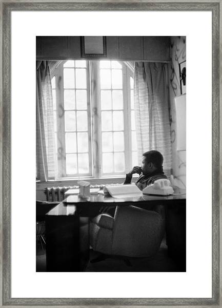 Sidney Poitier Looks Through A Window Framed Print by Gordon Parks