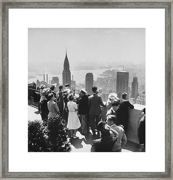 Sightseers Taking A Guided Tour On Top O Framed Print