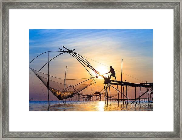 Silhouette Fishermen Are Using Nets Get Framed Print