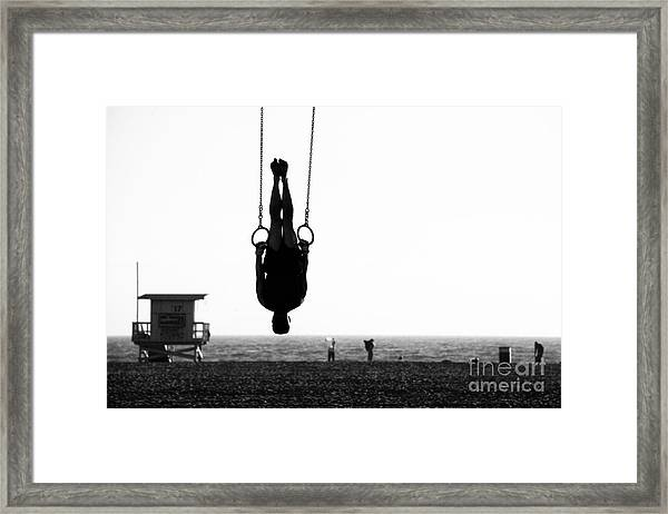 Silhouette Of A Person Swinging On Framed Print
