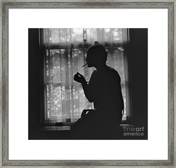 Silhouette Of A Stylish Women Smoking Framed Print