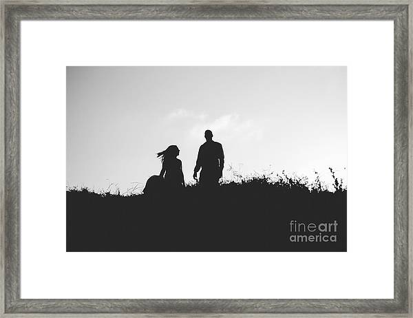 Silhouette Of Couple In Love With Wedding Couple On Top Of A Hil Framed Print