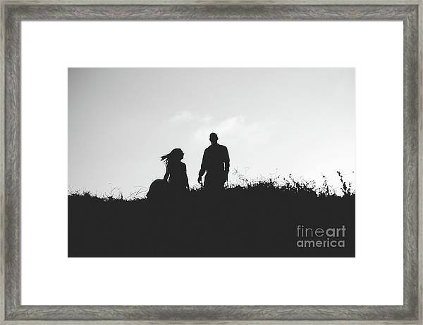 Silhouette Of Couple In Love With Wedding Couple On Top Of A Hill Framed Print