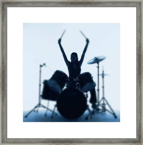 Silhouette Of Woman Playing Drums Framed Print