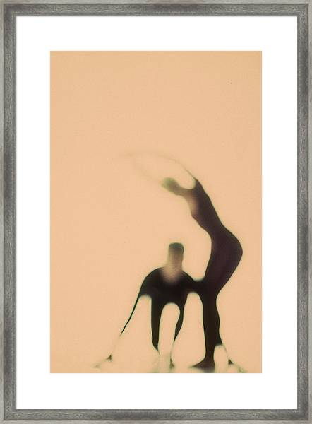 Silhouettes Of Couple Doing Exercises Framed Print by Arunas Klupsas