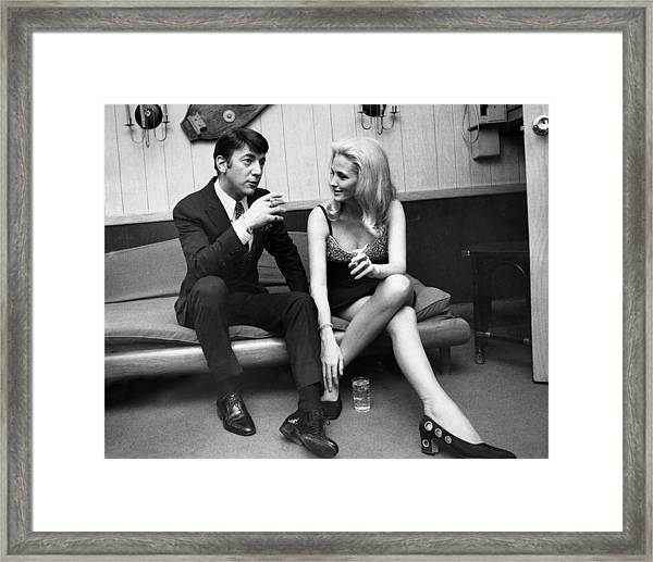 Singer Bobby Darin Sits With His Framed Print