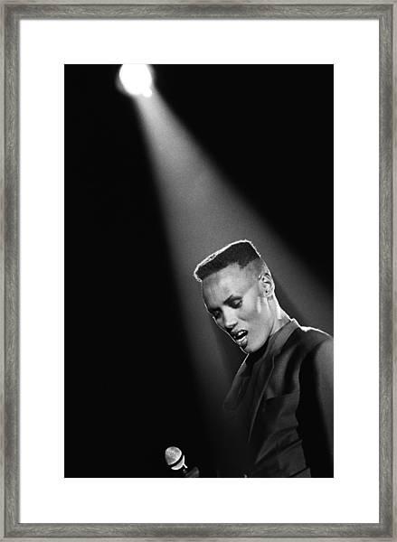 Singer Grace Jones In Concert Framed Print by George Rose