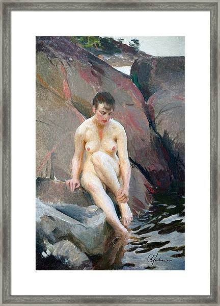 Sitting On A Cliff Framed Print
