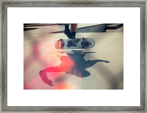 Skateboarder Doing An Ollie Framed Print by Devon Strong