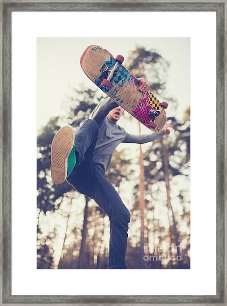Skater Guy Jumps Framed Print