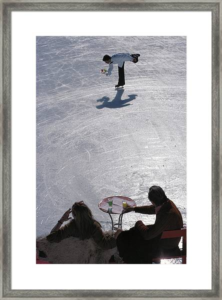 Skating Waiter Framed Print by Slim Aarons