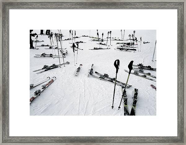 Ski Equipment On The Slopes At A Ski Framed Print