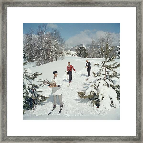 Skiing Waiters Framed Print